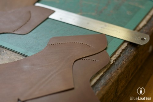 Shaped pieces of leather with some broguing on them